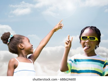 Digital composite of Kids pointing at sky and playing