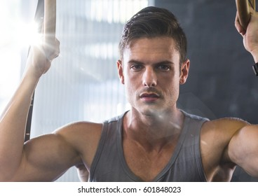 Digital composite of Man doing pull ups with flare
