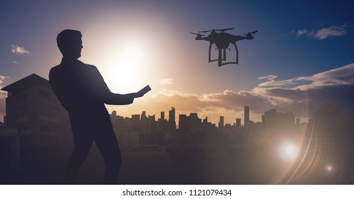 Digital composite of Man flying drone over city