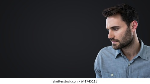 Digital composite of Man looking to the left against dark grey background