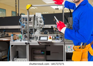 Digital composite of Midsection of handyman standing by machine