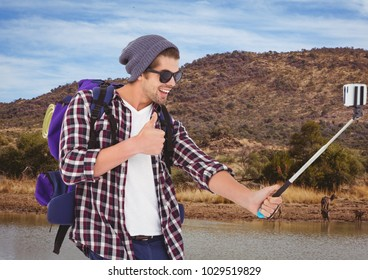 Digital composite of mountain travel, happy boy doing selfie with animals