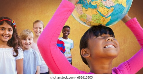 Digital composite of Multinational and multicultural children holding world globe with gold background