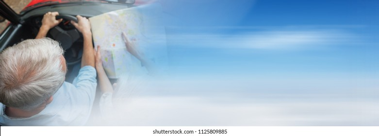 Digital composite of Old couple with map in car with transition effect