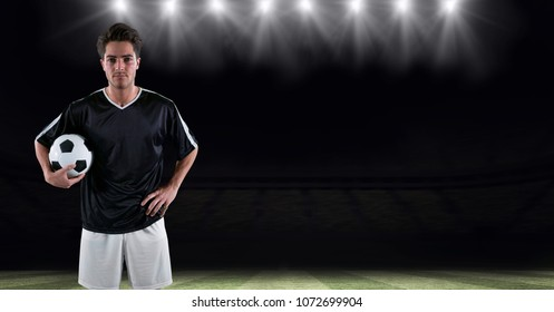 Digital composite of Player holding soccer ball at stadium
