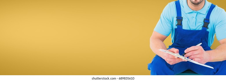 Digital composite of Plumber man sitting and writing against yellow background