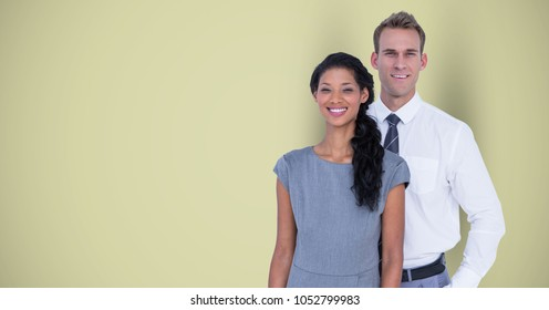 Digital composite of Portrait of confident business colleagues standing against green background