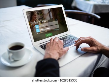 Digital composite of In a restaurant, hands with laptop. Login screen