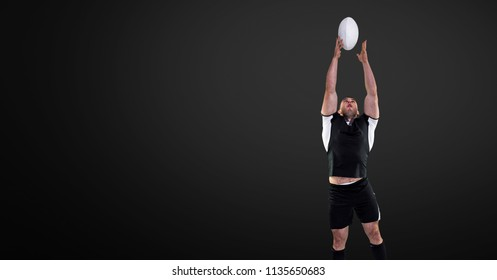 Digital composite of Rugby player jumping for ball with blank black background