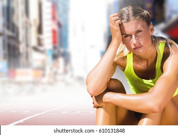 Digital composite of Sad disappointed athlete runner sitting down in city