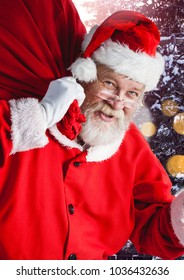 Digital composite of Santa with Winter landscape with sack