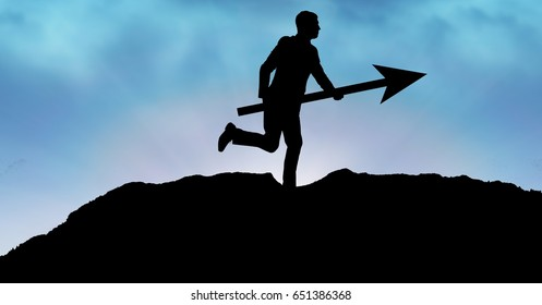 Digital composite of Silhouette businessman holding arrow sign on mountain