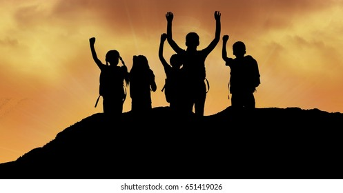 Digital composite of Silhouette children with arms raised on hill against sky during sunset