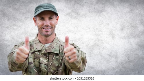 Digital composite of Soldier thumbs up against white wall with grunge overlay