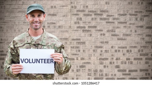 Digital composite of Soldier volunteer against brown brick wall