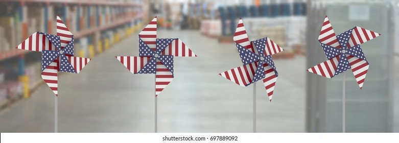 Digital composite of USA wind catchers in front of warehouse