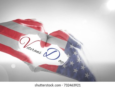Digital composite of Veterans day, flag usa on hands with text