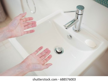 Digital composite of Washing hands in sink