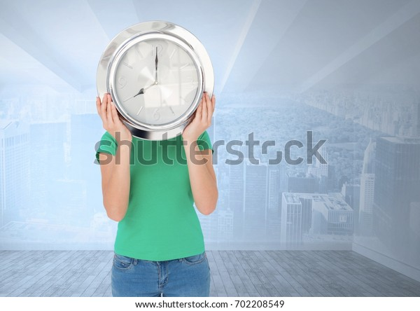 Digital composite of Woman holding clock in front of city room