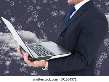 Digital composition of businessman holding laptop with connecting icons and cloud in background