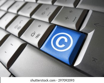 Digital copyright web content and Internet concept with copyright symbol and icon on a blue laptop computer key for blog, website and online business.