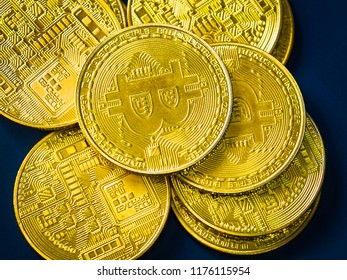 digital currency and financial concept from close up group of gold bitcoin arrange on blue background
