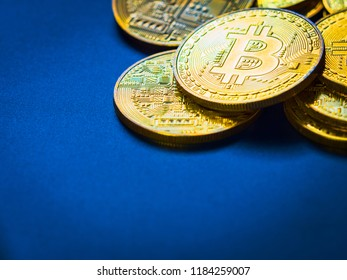 digital currency and financial concept from close up group of gold bitcoin arrange on blue and soft focus background with copy space