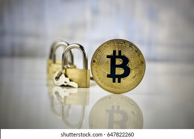 Digital currency physical gold bitcoin coin - padlocks concept.