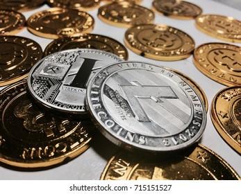 Digital currency physical metal litecoin coin near bitcoin coins. Money concept.