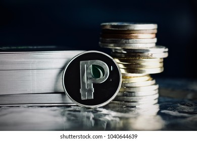 Digital currency physical metal silver peercoin coin with green leaf.