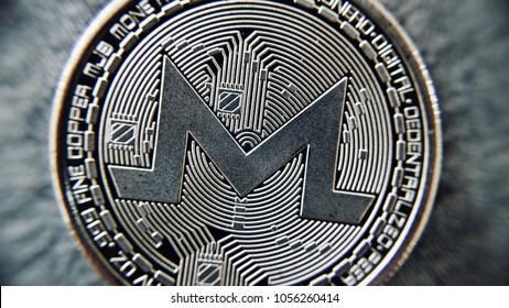 Digital currency physical metal silver monero coin. Monero closeup concept.