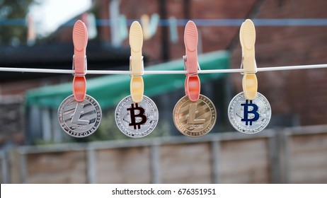Digital currency physical silver and gold bitcoins and litecoins on the line.