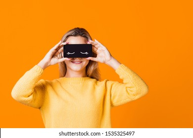 Digital detox, the icon of closed eyes on the smartphone screen, applications that help to observe the mode of the day, the concept.
