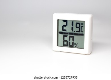 Digital device measuring temperature and humidity. Thermometer and hygrometer. Celsius and percent.