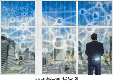 Digital disruption concept background. Business man looking double exposure of city and digital code abstract outside the building.