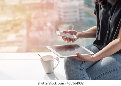 Digital easy lifestyle blog writer at home or business person at work using smart device working on internet communication technology, reading e-book, paying online banking e-commerce payment
