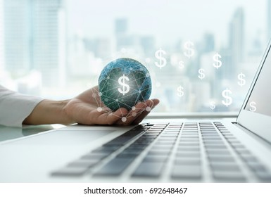 digital economy and income online concept. global on hand with network revenue dollar money icon and laptop computer.
