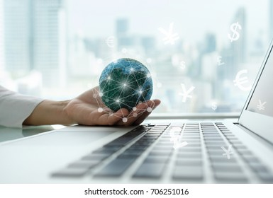digital economy and income online concept. global on hand with network revenue icon and laptop computer.