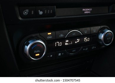 Digital electronic dual air conditioning and heating system in a automobile car with knobs to adjust the temperature of the air coming through fans, so vehicle is a comfortable heat inside