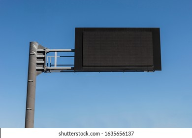 Digital Empty Road Signboard in the blue sky background.