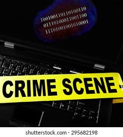 digital fingerprint on a laptop with crime scene tape