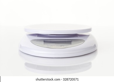 Digital food scale electronic weight balance on white backgroound.