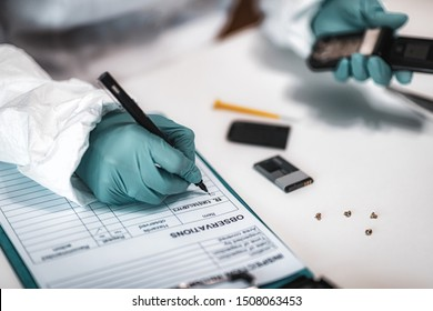 Digital Forensic Science. Police Forensic Analyst Examining Confiscated Mobile Phone.