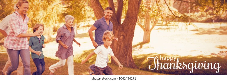 Digital generated image of thanksgiving greeting against happy family playing soccer