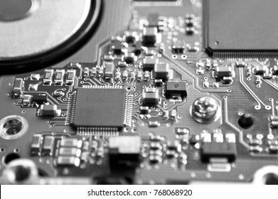 Digital hardware closeup. Microchips and condensers assembly on the circuit board macro