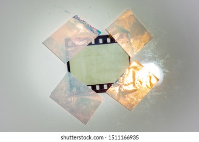 digital high res photo of blank 35mm film border or frame fixed on white background with 4 holo stickers, just blend in your photo here, cool poster picture placeholder, lamp shining on film material