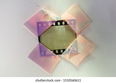 digital high res photo of empty or blank 35mm film strip fixed by 4 shiny holo stickers on glas background, cool photo placeholder for your content
