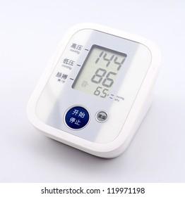 Digital home blood pressure meter isolated