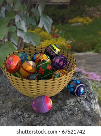 Digital illustration of colorful easter eggs in a basket outside in a garden. Eggs in Ukrainian style designs.