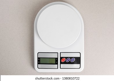 Digital kitchen scales on gray background. Copy space